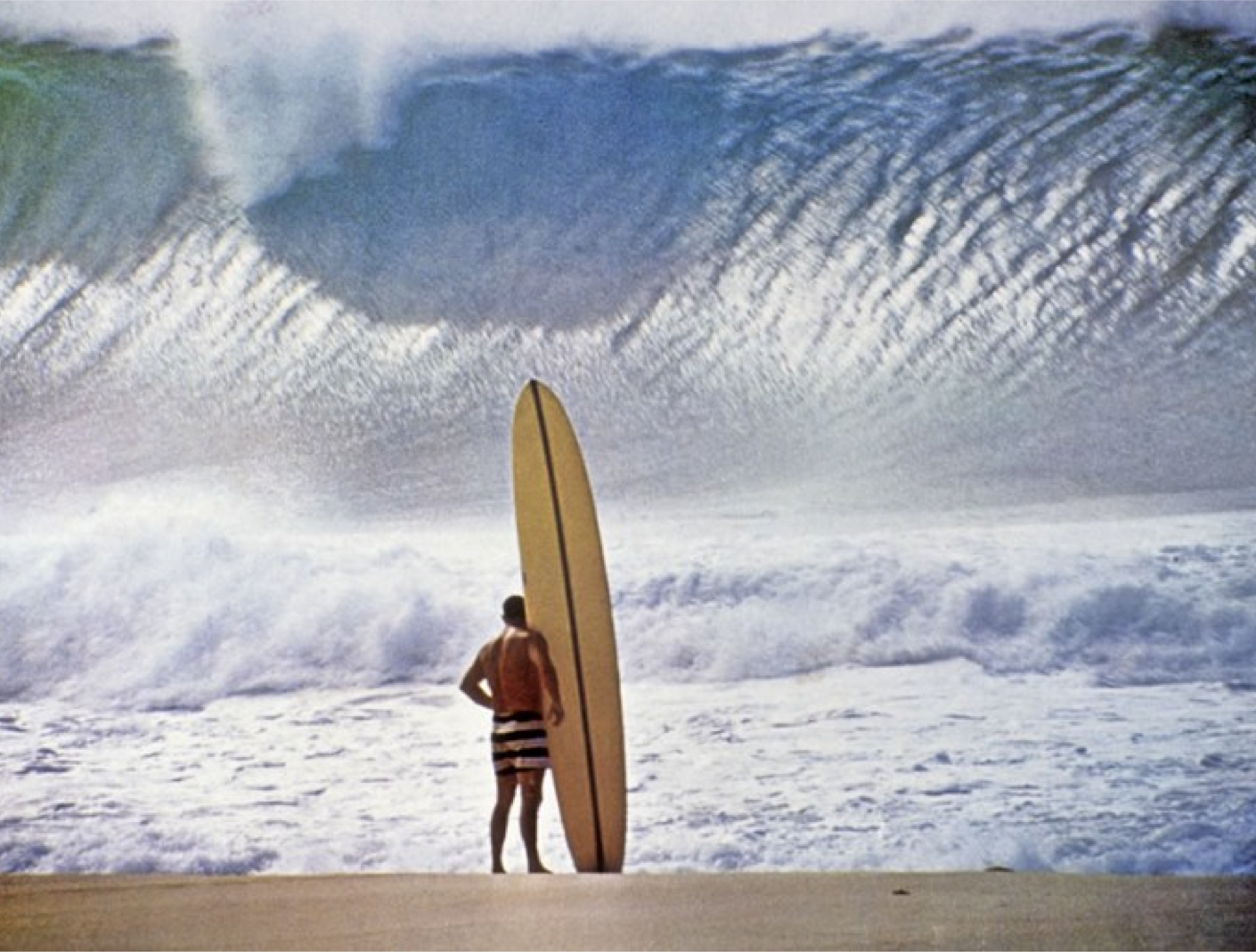Photo Credit: John Severson 1964 The most iconic surfing pic ever. Greg Noll, Waimea Bay.